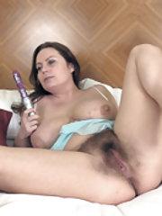 Alexis May masturbates with her purple vibrator
