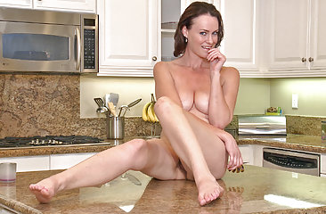 Hairy woman Veronica Snow cooking in the kitchen