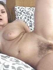 Bella Moore masturbates in bed after reading