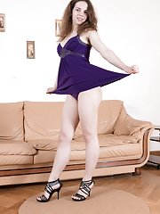 Fiorella strips off purple dress on her brown sofa