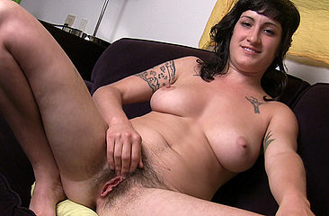Stacey Stax talks about her perfect date while pleasuring her wet moist hairy pussy on the sofa.