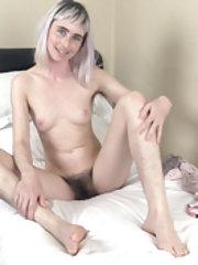 Esme masturbates in bed all dressed in pink