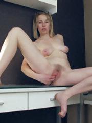 Natinella masturbates after working at her desk