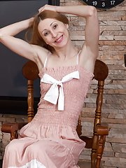 By her wooden chair Amanda S gets naked