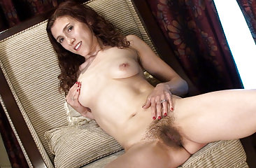 Hairy girl Amanda gets cozy in the living room