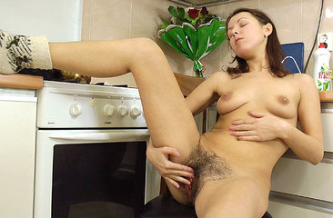 Roxy is finally done with all of her studying. Wearing her lingerie she decides to make a little snack, but gets distracted by her hairy body instead, starting with her moist hairy pussy.