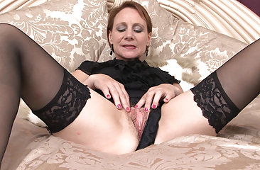 Tiffany T fingers her hairy pussy after work