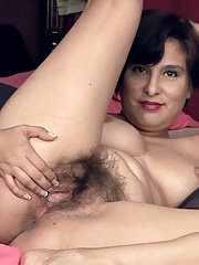 Lucy Dutch relaxes on bed to play with her body