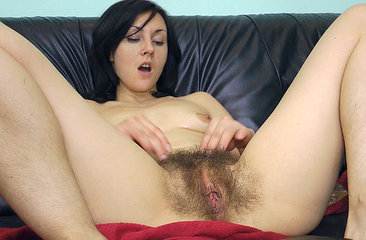 Kristy oils up her hairy pussy to finger herself