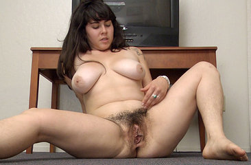 Cleo shows her big tits and hairy pussy