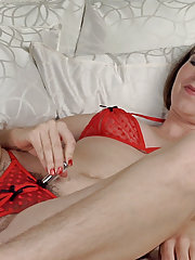 Camille masturbates with toys on white bed