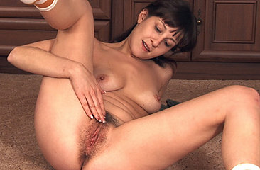 Sexy Paulina pulls off her shorts and finger fucks her tender moist bush on the floor of the living room!