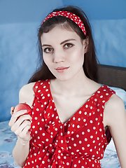 Maia models a red dress and masturbates in bed