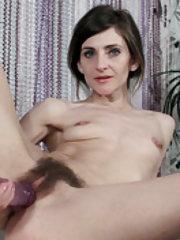Olivia Arden masturbates with a dildo on her table