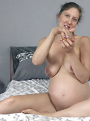 A pregnant Valentine enjoys hot fun in bed