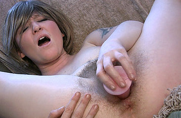 After sucking her big pink dildo as if it was a throbbing cock, Samantha arches her back and jams it deep into her hairy pussy until she cums.