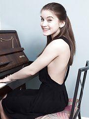 Evelina Darling masturbates by her piano