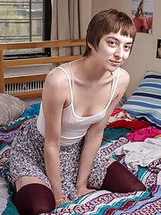 Thin short haired amateur Jill disrobing and showing her hairy crack