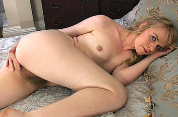 Horny blonde Heidi Bush can\'t get enough off her hairy bush. She admires it in the mirror and even in her own photos. The thought of all that soft hair turns her on.
