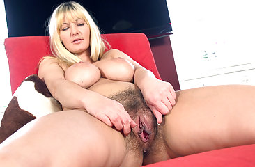 Busty Vanessa J rubs her big tits all the way down to her legs before rubbing up to her wet hairy pussy through her black hot shorts. She takes them off and fingers her hairy pussy right there.