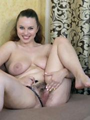 Adelia Rosa strips naked and masturbates on a sofa