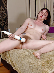 Hairy Thelma Sleaze masturbates by the fireplace