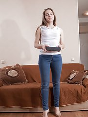 Sirena masturbates with her new vibrator on sofa