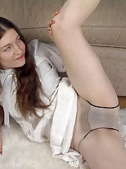 Mahonia spreads her legs and masturbates on rug