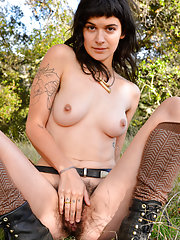 Hairy hipster girl Liv naked wearing boots outside
