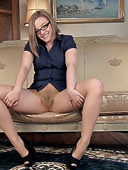 On gold sofa, Kylie Harris strips in stockings