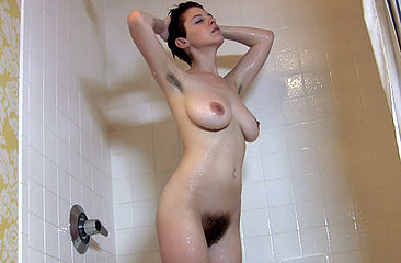 Get steamy and flustered with sexy RyAnne in the shower...her warm, hairy pussy moistens as the hot soapy water runs over her precious little pink lips.