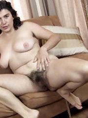 Left alone Serai undresses and masturbates on sofa