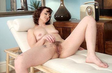 Chrissie watches herself as she masturbates