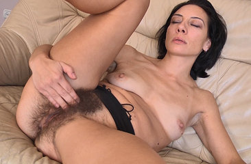 Eva spreads and plays with her hairy pussy