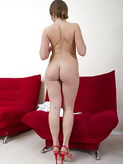 Gilian loves red and strips naked on red chair