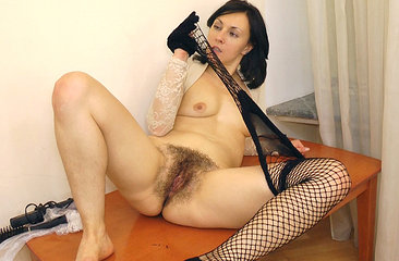 Kinky Kristy peels off her stockings and reveals her hairy box