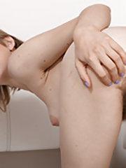 Tia Jones strips and puts on erotic naked show