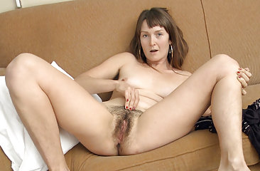 Charlotte B is lounging around in nothing but a Tshirt and a pair of cowboy boots. It's no wonder she winds up touching her hairy body all over, giving her hairy pussy some extra special attention.
