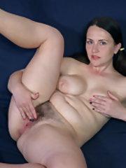 Animee strips naked and masturbates on her sofa