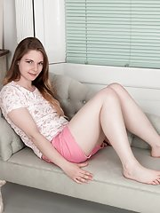 Dressed in pink finds Alice Wonder on sofa