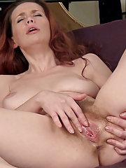 Mystique masturbates on her bed sucking her tits