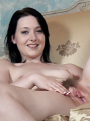 Aminora strips and oils body while on her chair