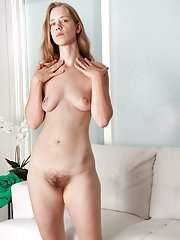 In the living room, April strips in green dress
