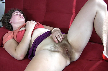 Meg talks about some of her memorable sexual encounters and gets horny just thinking about it. She had better lay back on the sofa and finger bang her moist pink pussy.
