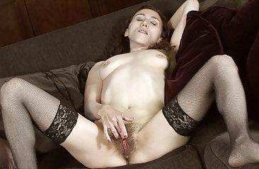 Hairy girl Amanda gets down to masturbating