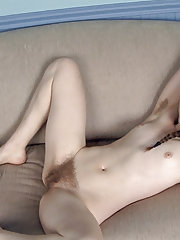 Mahonia strokes her hairy pussy after stripping
