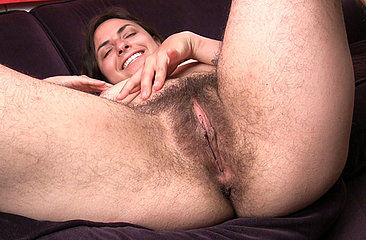 Monica quickly tickles her clit and fingers her meaty bush on the sofa. The thought of hairy girls got her too hot!