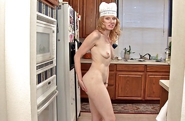 Lacey plays with her hairy pussy in the kitchen