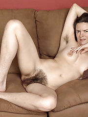 Lucia strips from pink outfit to naked on sofa