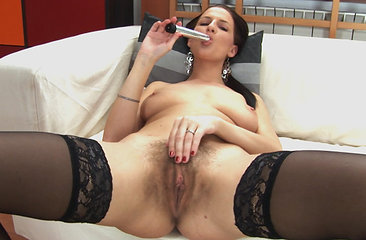 Walleria tastes her hairy pussy with a quick suck between driving it into her bush on the sofa. This natural beauty sure knows how to work it!
